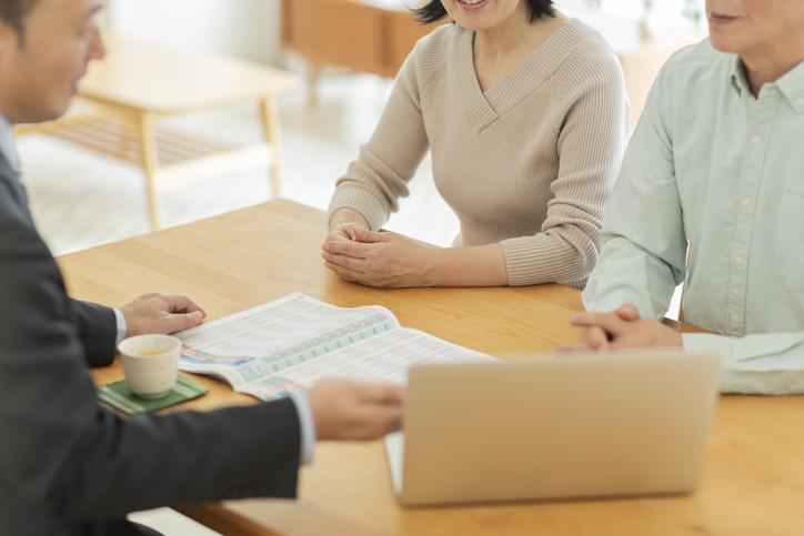 Businessman explaining to middle aged couple