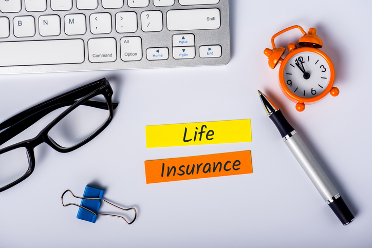 Life insurance - text on insurer workplace. Healthcare, accident and medical insurance concept.